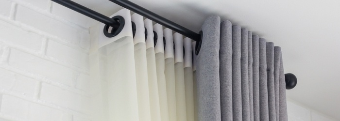 Hang curtains or blinds